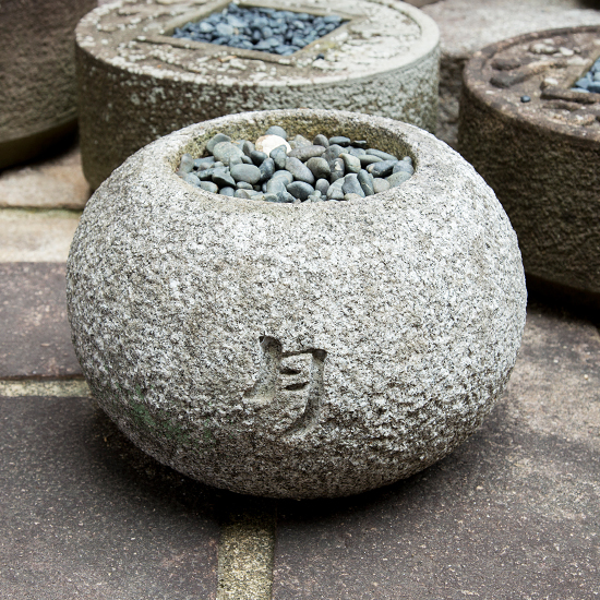 """Tsuki hachi (water basin for Japanese garden) A letter of Chinese character """"月"""" (moon) is curved on the water basin."""
